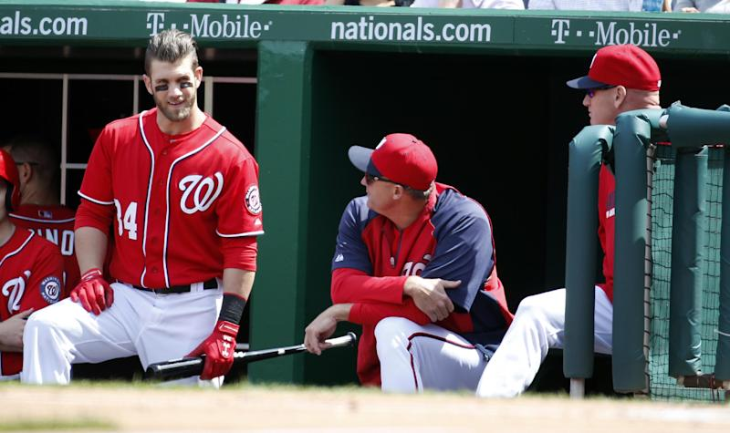 Washington Nationals' Bryce Harper, left, stands in the dugout with bench coach Randy Knorr, and manager Matt Williams before Harper bats during the third inning of a baseball game against the St. Louis Cardinals, Sunday, April 20, 2014, in Washington. (AP Photo/Alex Brandon)