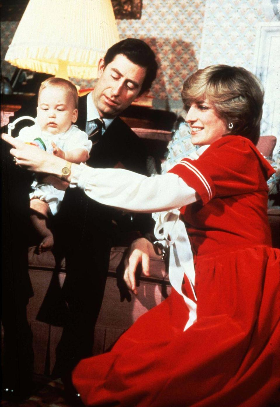 <p>Princess Diana and Prince Charles with a young Prince William at Kensington Palace around Christmastime.</p>