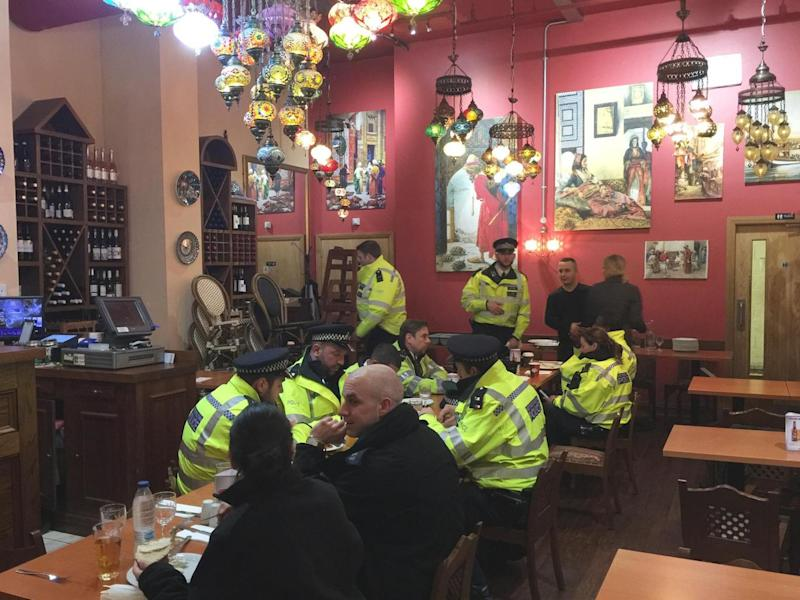 Emergency workers eat at Ibrahim Dogus' Troia restaurant ()