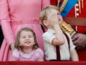 <p>Princess Charlotte and Prince George (looking slightly unimpressed) watch the flypast from the balcony of Buckingham Palace during the Trooping the Colour.</p>