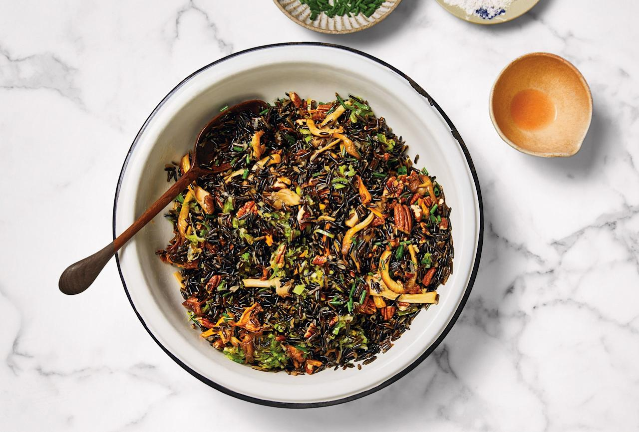 "This savory wild rice dish is the ultimate gluten-free stuffing and doubles as a holiday-appropriate grain salad with lots of fresh herbs. Cook the grains in well-salted water for much longer than you'd think; until the rice is splitting open, it's not done. <a href=""https://www.bonappetit.com/recipe/wild-rice-dressing?mbid=synd_yahoo_rss"">See recipe.</a>"