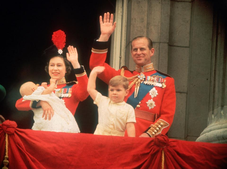 Queen Elizabeth, Prince Philip, Prince Andrew and Prince Edward waving to the crowds during the Trooping of the Color at Buckingham Palace.