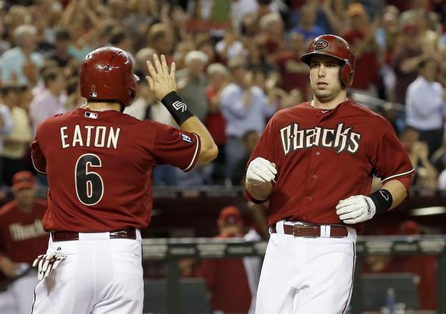 Arizona Diamondbacks' Paul Goldschmidt, right, gets ready for a high-five from teammate Adam Eaton (6) after hitting a two-run home run against the Los Angeles Dodgers in the first inning during a baseball game on Wednesday, Sept. 18, 2013, in Phoenix. (AP Photo/Ross D. Franklin)
