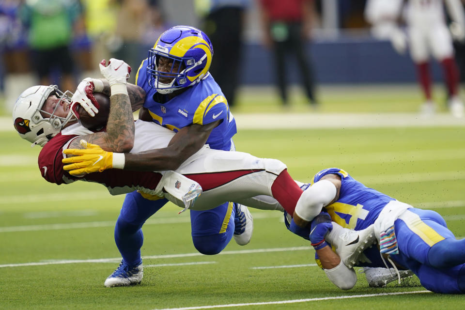 Arizona Cardinals tight end Maxx Williams is tackled by Los Angeles Rams linebacker Ernest Jones, top center, and safety Taylor Rapp, right, during the first half in an NFL football game Sunday, Oct. 3, 2021, in Inglewood, Calif. (AP Photo/Ashley Landis )