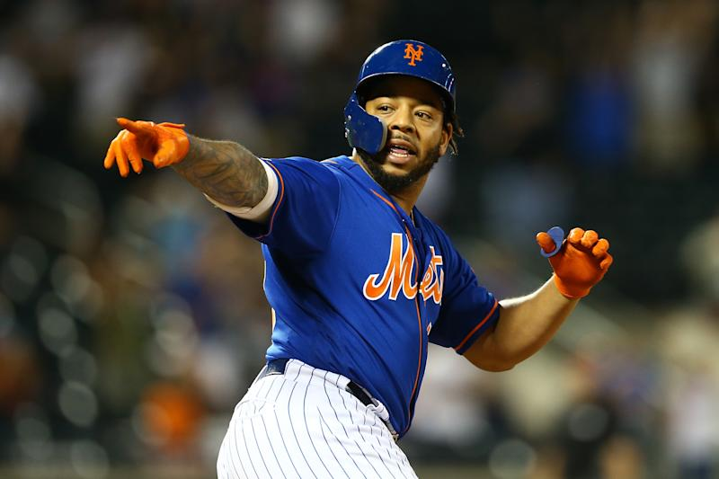 NEW YORK, NEW YORK - SEPTEMBER 29: Dominic Smith #22 of the New York Mets celebrates after hitting a walk-off 3-run home run in the bottom of the eleventh inning against the Atlanta Braves at Citi Field on September 29, 2019 in New York City. (Photo by Mike Stobe/Getty Images)