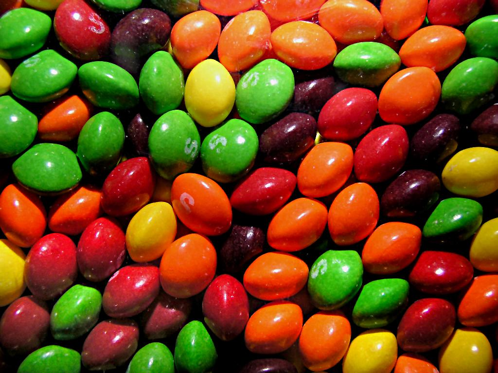<p>Don't put these chewy rainbow candies on the healthy list, but do put them on the vegan list. When they first came out in 1979 they weren't vegan because they contained cochineal. But over the years Skittles has removed this ingredient, which incidentally is red food dye taken from a crushed female cochineal insect. </p>