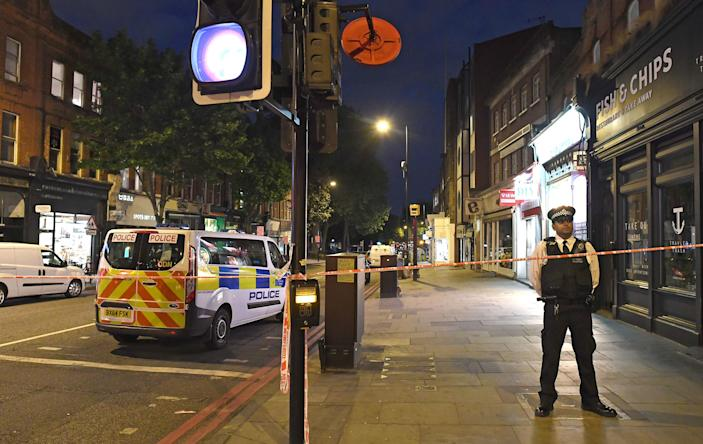 Police at the scene of the stab death of Marcel Campbell in Upper Street, Islington, in May 2018. He was killed across the road from where JJ McPhillips was knifed in February 2017. (PA)