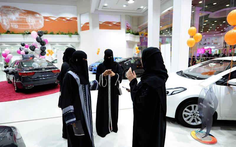 Saudi women tour a car showroom for women on January 11, 2018, in the Saudi Red Sea port city of Jeddah. - AFP