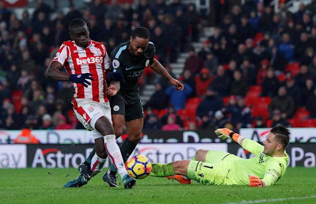 "Soccer Football - Premier League - Stoke City vs Manchester City - bet365 Stadium, Stoke-on-Trent, Britain - March 12, 2018 Manchester City's Raheem Sterling in action with Stoke City's Papa Ndiaye Action Images via Reuters/Andrew Couldridge EDITORIAL USE ONLY. No use with unauthorized audio, video, data, fixture lists, club/league logos or ""live"" services. Online in-match use limited to 75 images, no video emulation. No use in betting, games or single club/league/player publications. Please contact your account representative for further details."