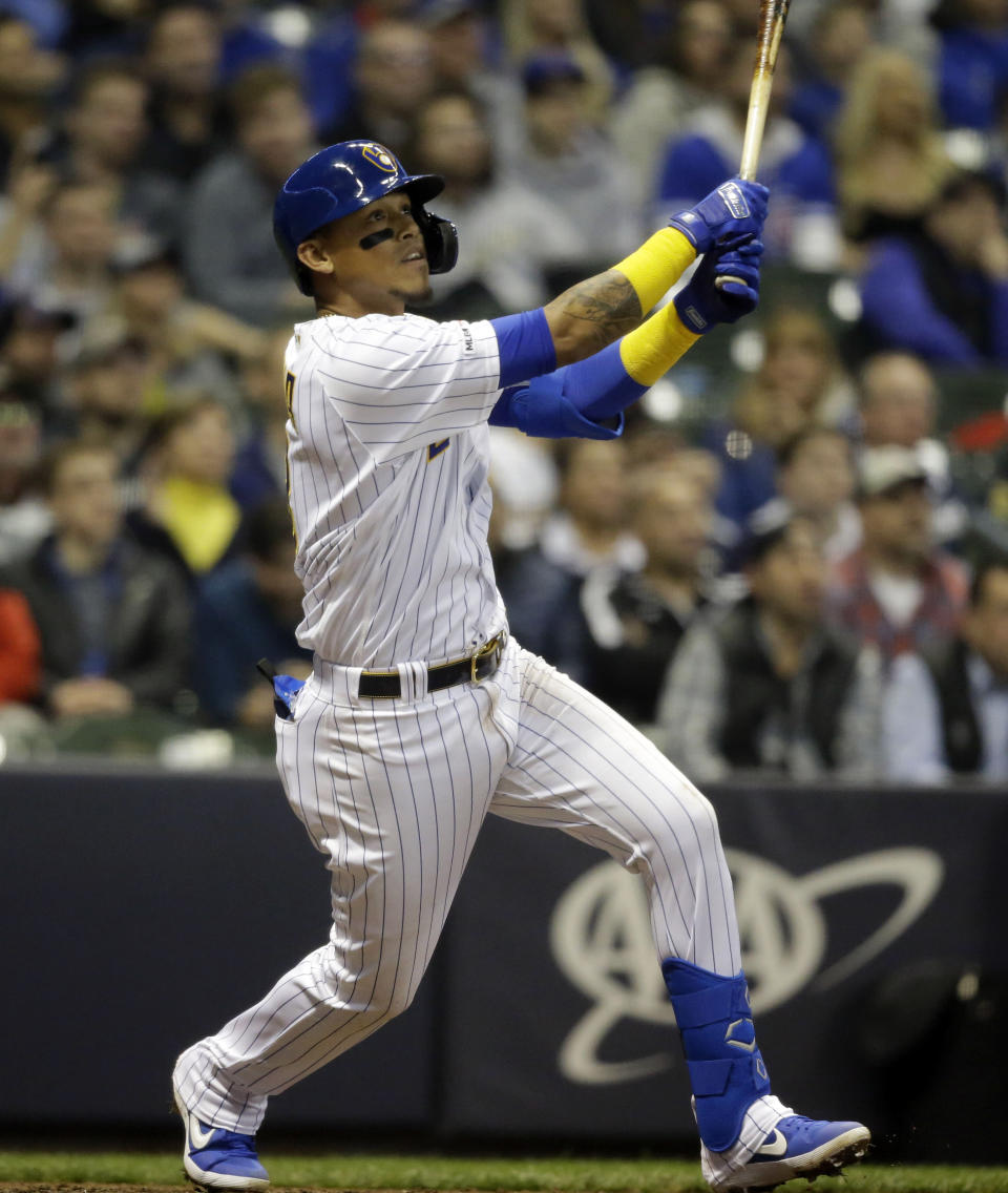 Milwaukee Brewers' Orlando Arcia watches his home run against the Chicago Cubs during the third inning of a baseball game Friday, April 5, 2019, in Milwaukee. (AP Photo/Jeffrey Phelps)
