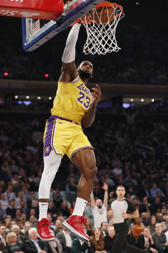 Los Angeles Lakers forward LeBron James (23) dunks with no one around defending him during the first half of an NBA basketball game against the New York Knicks in New York, Wednesday, Jan. 22, 2020. (AP Photo/Kathy Willens)
