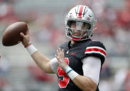 FILE - Ohio State quarterback Jack Miller throws on the sideline during an NCAA college spring football game in Columbus, Ohio, in this Saturday, April 17, 2021, file photo. Third-year Ohio State coach Ryan Day opens a preseason camp for the first time without a good idea of who will be the starting quarterback.(AP Photo/Paul Vernon, File)