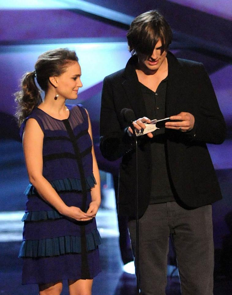 "Newly engaged star Natalie Portman hit the stage at the People's Choice Awards in L.A. with Ashton Kutcher Wednesday night. The ""Black Swan"" actress was wearing a very pretty Jason Wu frock, but all attention was focused on her cute, petite baby bump and her brand new engagement ring -- which she somehow managed to keep under wraps for the whole show. Jeff Kravitz/<a href=""http://www.filmmagic.com/"" target=""new"">FilmMagic.com</a> - January 5, 2011"