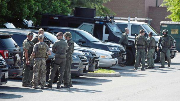 PHOTO: Tactical police stage in a Safeway parking lot on Belair Road near Chapel Road in response to the death of a Baltimore County police officer in Perry Hall, Md., May 21, 2018. (Jerry Jackson/The Baltimore Sun via AP)