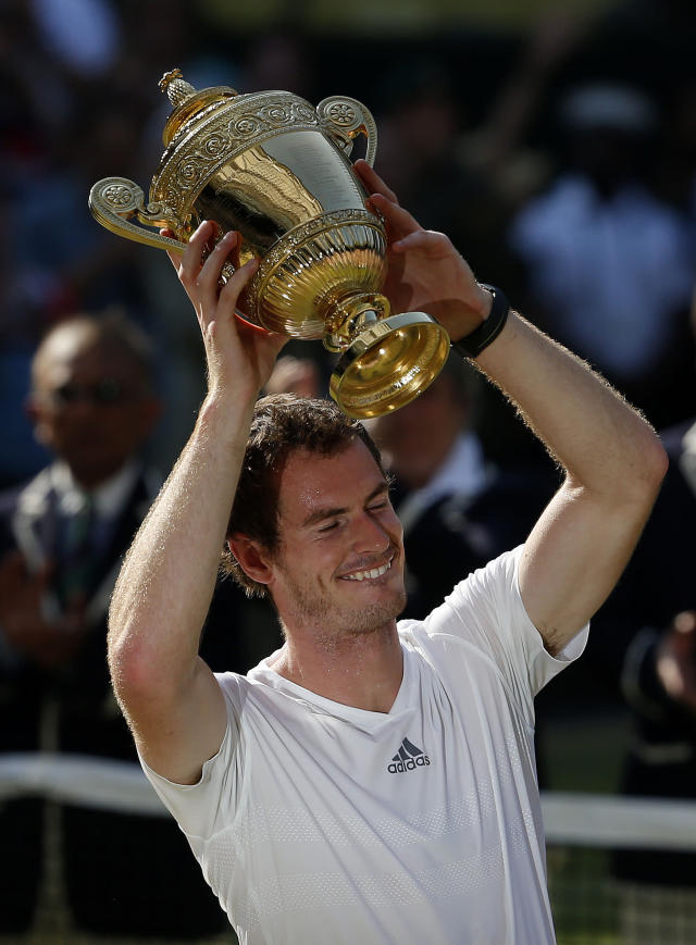 Great Britain's Andy Murray celebrates with the trophy after defeating Serbia's Novak Djokovic in the Men's Final during day thirteen of the Wimbledon Championships at The All England Lawn Tennis and Croquet Club, Wimbledon.