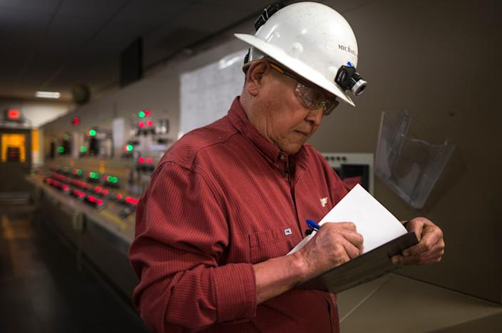 Michael Bigman signs in at the control room on Aug. 20, 2019, at the Navajo Generating Station in Page, Arizona.