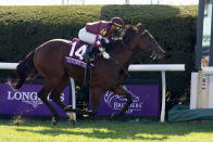 Golden Pal, ridden by Irad Ortiz Jr., crosses the finish line to win the Breeders' Cup Juvenile Turf Sprint horse race at Keeneland Race Course, Friday, Nov. 6, 2020, in Lexington, Ky. (AP Photo/Michael Conroy)