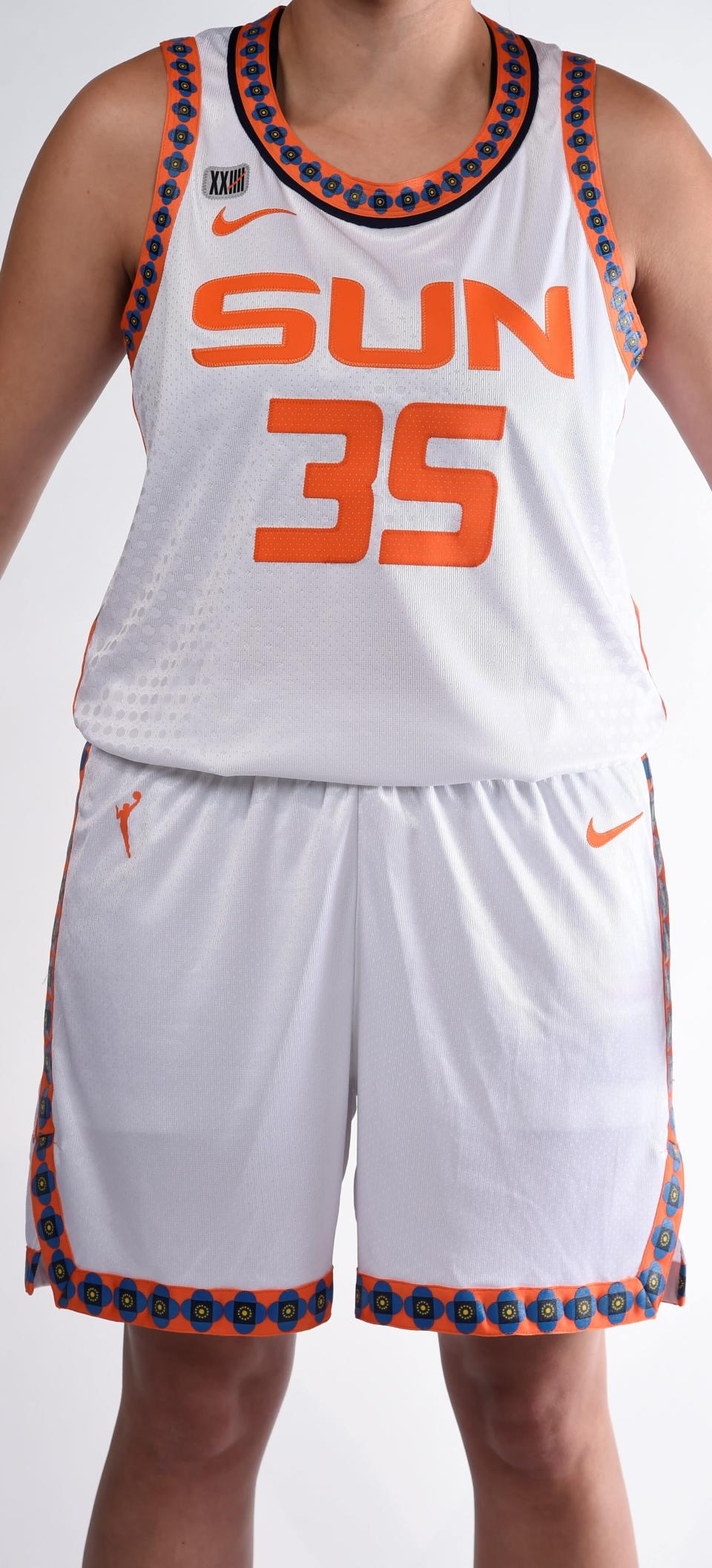 """This photo provided by Connecticut Sun on Thursday, April 8, 2021, shows the new Nike """"Heroine"""" edition uniform for the Connecticut Sun WNBA team. As numerous sports teams continue to come under fire for using Native American names and symbols, The Connecticut Sun is putting them on their new jerseys with the input of the team's owners—the Mohegan Indian tribe. (Connecticut Sun/Khoi Ton via AP)"""