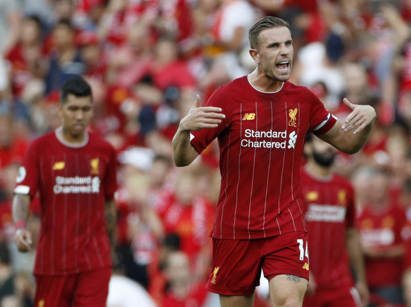 Liverpool's Jordan Henderson celebrates after the English Premier League soccer match between Liverpool and Arsenal at Anfield stadium in Liverpool, England, Saturday, Aug. 24, 2019. (AP Photo/Rui Vieira)