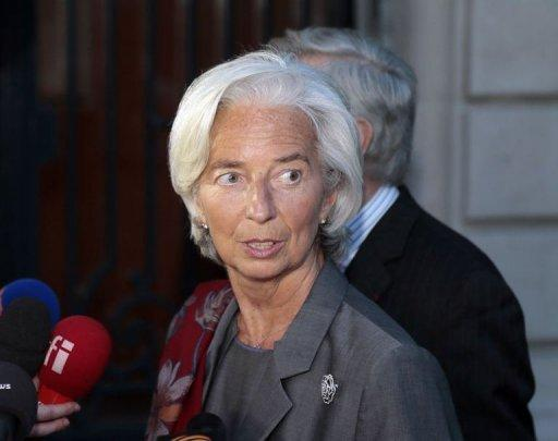 IMF chief Christine Lagarde speaks to the press as she leaves the French Republic Justice Court on May 24, 2013 in Paris