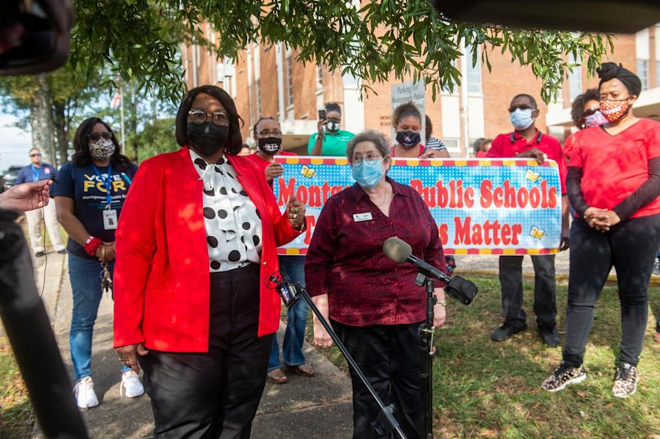Montgomery Public Schools board Vice President Claudia Mitchell and board President Clare Weil speak during a protest at the MPS central office in Montgomery, Ala., on Tuesday, which was the first day of in-person classes after nine weeks of virtual learning because of the coronavirus.