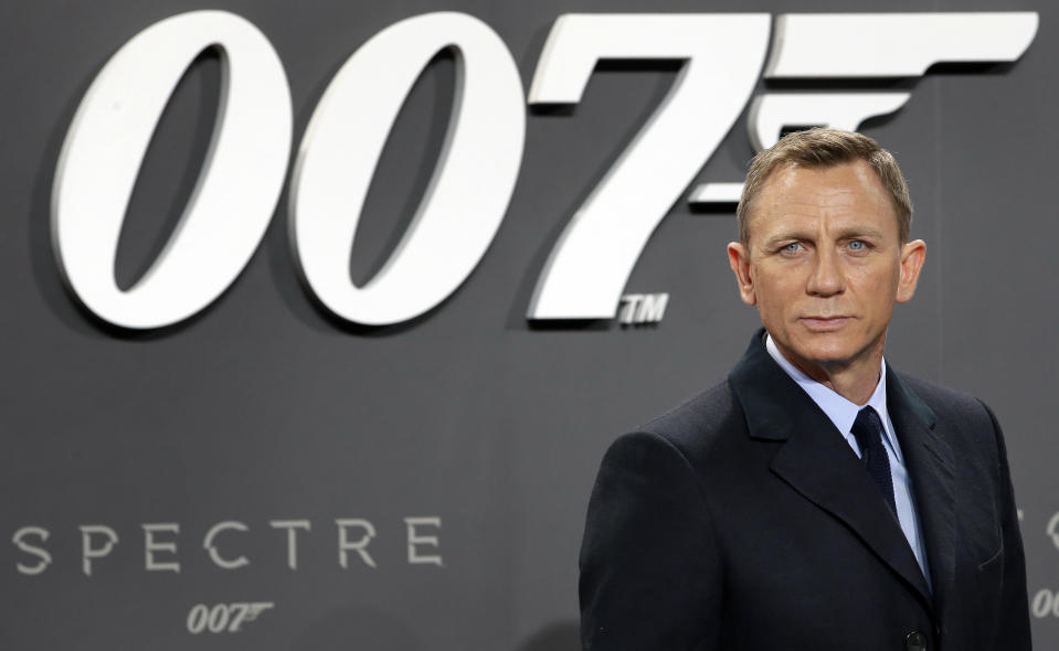 """FILE - In this Oct. 28, 2015, file photo, actor Daniel Craig poses for the media as he arrives for the German premiere of the James Bond movie 'Spectre' in Berlin, Germany. Craig announced on """"The Late Show with Stephen Colbert"""" Aug. 15, 2017, that he would return as the British super spy in 2019's """"Bond 25."""" (AP Photo/Michael Sohn, File)"""
