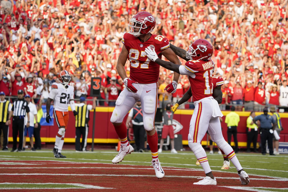Kansas City Chiefs' Travis Kelce, left is congratulated by Mecole Hardman (17) after scoring during the second half of an NFL football game against the Cleveland Browns Sunday, Sept. 12, 2021, in Kansas City, Mo. (AP Photo/Ed Zurga)