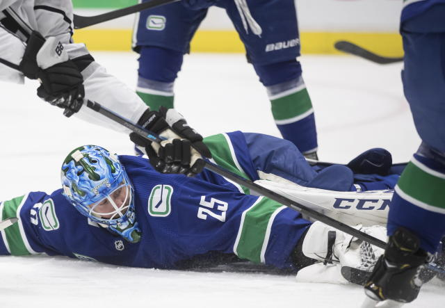 Vancouver Canucks goalie Jacob Markstrom, of Sweden, makes a save against the Los Angeles Kings during the first period of an NHL hockey game Wednesday, Oct. 9, 2019, in Vancouver, British Columbia. (Darryl Dyck/The Canadian Press via AP)