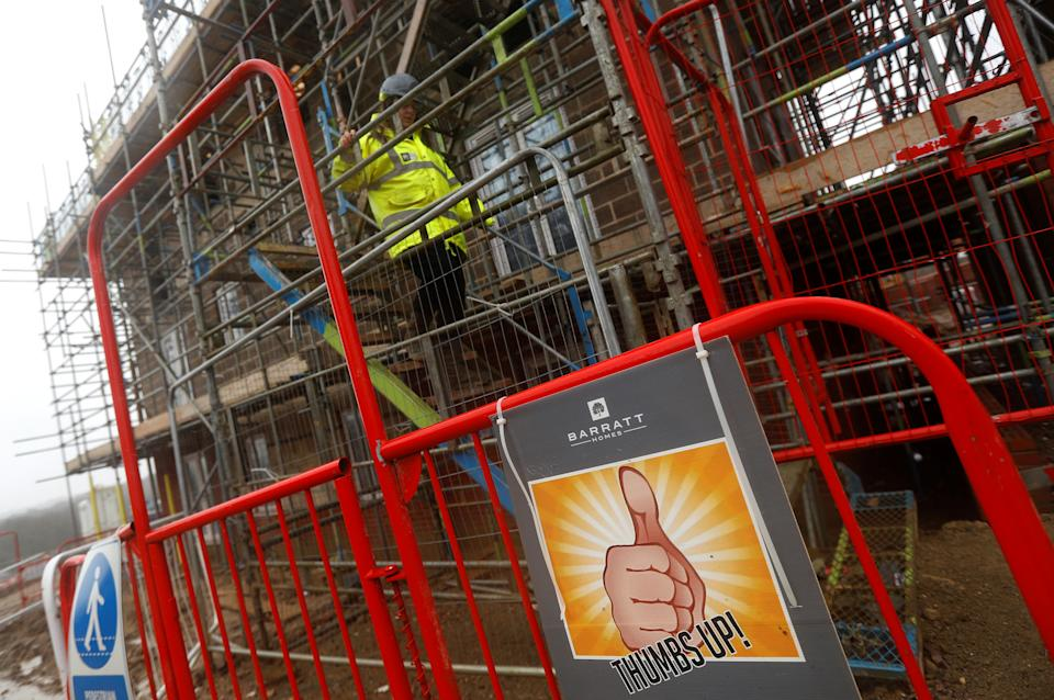 A Barratt employee walks down scaffolding at a Barratt housing development near Haywards Heath, Britain, February 20, 2020. REUTERS/Peter Nicholls
