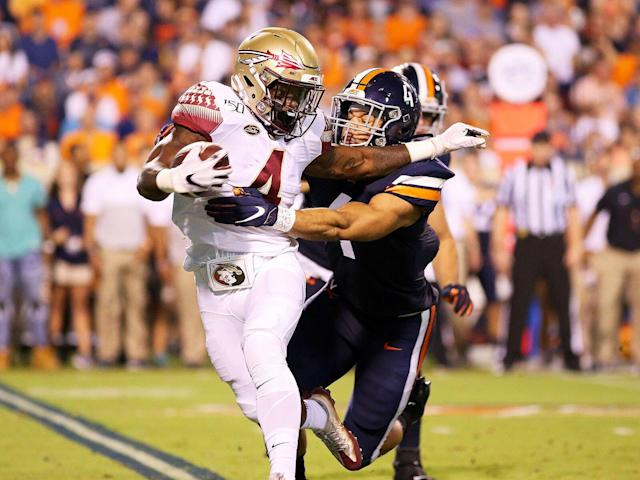 <p>Jordan Mack of Virginia chases down Khalan Laborn of the Florida State in the first half during a game at Scott Stadium.</p>