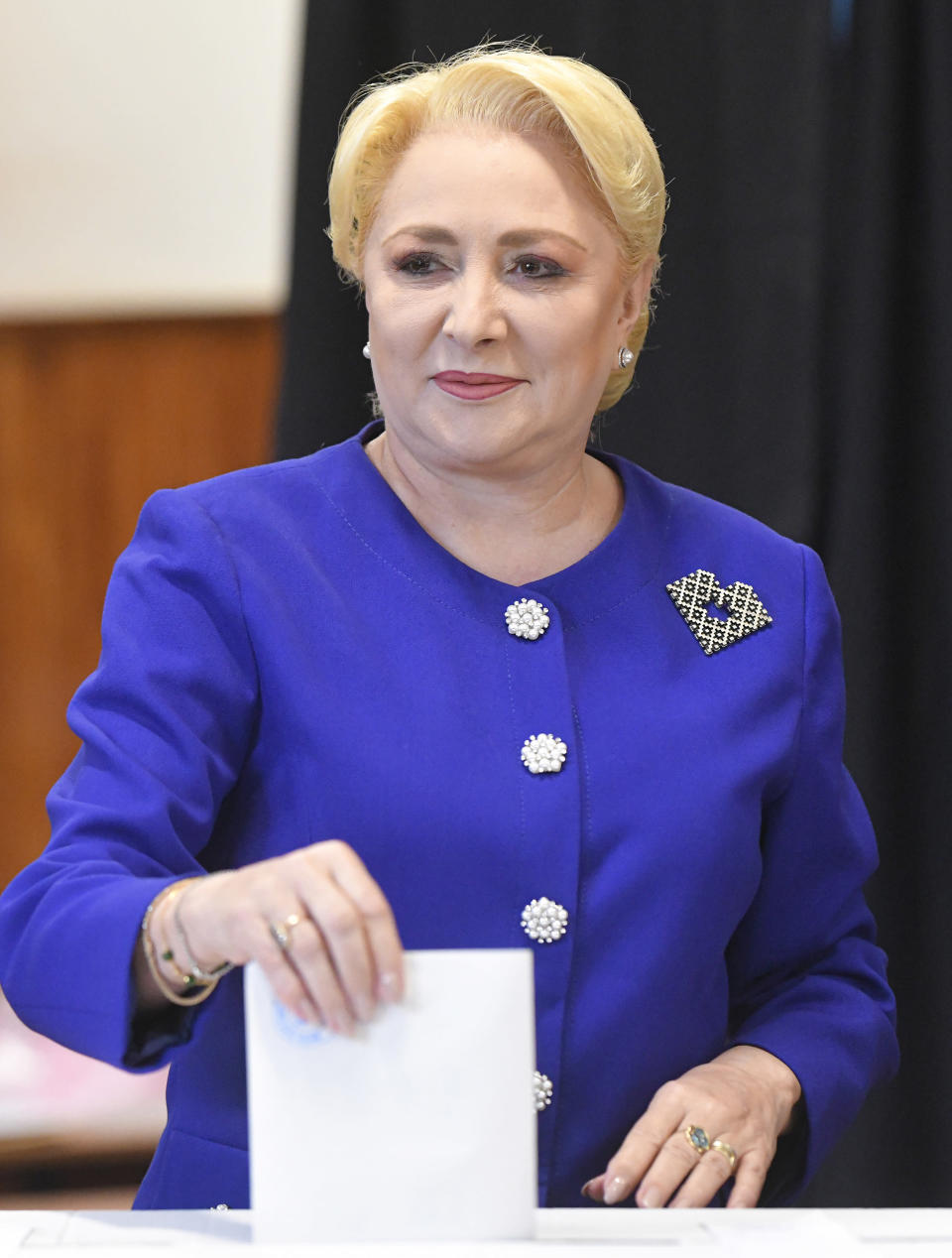Former Prime Minister and presidential candidate for the Social Democratic party Viorica Dancila casts her vote in Bucharest, Romania, Sunday, Nov. 10, 2019. Voting got underway in Romania's presidential election after a lackluster campaign overshadowed by a political crisis which saw a minority government installed just a few days ago. (AP Photo/Andreea Alexandru)