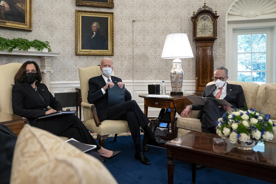 WASHINGTON, DC - FEBRUARY 03: U.S. President Joe Biden (C) and Vice President Kamala Harris meet with Senate Majority Leader Charles Schumer (D-NY) and other Democratic senators to discuss his $1.9 trillion American Rescue Plan in the Oval Office at the White House on February 03, 2021 in Washington, DC. In an effort to generate bipartisan support for his plan, Biden met with Republican senators a day earlier to discuss his COVID-19 relief plan, which Democrats are working to push through Congress with or without the GOP. (Photo by Stefani Reynolds-Pool/Getty Images)