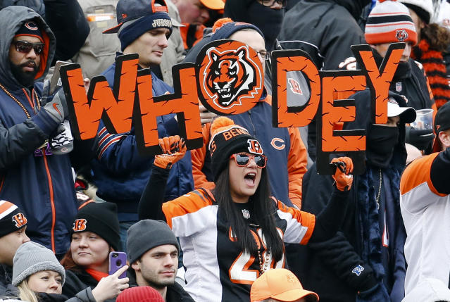 FILE - In this Dec. 10, 2017, file photo, Cincinnati Bengals fans cheer in the stands during the first half of an NFL football game against the Chicago Bears in Cincinnati. Here comes Who Dey vs. Who Dat. Say what? The Who Dat folks from New Orleans go head-on with the Who Dey fans in Cincinnati on Sunday. And don't ask which group first came up with its catchy phrase and odd rendering of the English language. (AP Photo/Frank Victores, File)