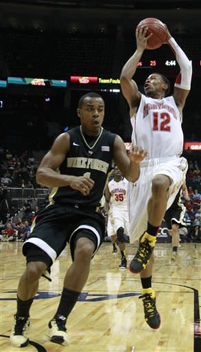 Maryland guard Terrell Stoglin (12) shoots as Wake Forest guard Tony Chennault (1) defends in the first half of an NCAA college basketball first round game at the Atlantic Coast Conference tournament, Thursday, March 8, 2012, in Atlanta. (AP Photo/John Bazemore)