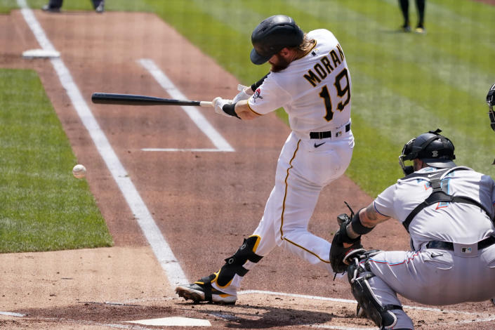 Pittsburgh Pirates' Colin Moran (19) hits a double down the first baseline, driving in a run, during the first inning of a baseball game in Pittsburgh, Sunday, June 6, 2021. (AP Photo/Gene J. Puskar)