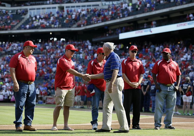 Texas Rangers CEO Nolan Ryan, shakes hands with West, Texas, first responders before a baseball game between the Houston Astros and the Rangers on Saturday, July 6, 2013, in Arlington, Texas. The Rangers hosted a night to honor residents and first responders from the town devastated by a fertilizer plant explosion. (AP Photo/Tony Gutierrez)
