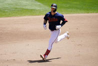 Minnesota Twins' Ryan Jeffers rounds the bases on a two-run home run off Cincinnati Reds' pitcher Wade Miley in the fourth inning of a baseball game, Tuesday, June 22, 2021, in Minneapolis. (AP Photo/Jim Mone)
