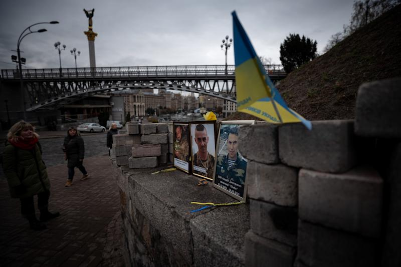 "A women looks at the photos of protesters who were killed during the Euromaidan revolution at the memorial of ""Heavenly 100"" at Independence square in Kiev, Ukraine on October 28, 2019. (Photo: Agron Dragaj for Yahoo News)"