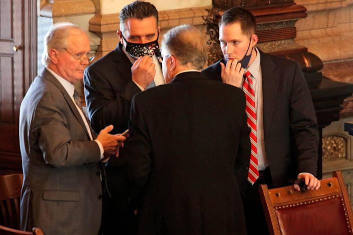 'Clockwise from the far left, Senate Majority Leader Gene Suellentrop, R-Wichita; Senate President Ty Masterson, R-Andover; Chase Blasi, Masterson's operations chief, and Sen. Mike Thompson, R-Shawnee, conferring in Topeka in early March.