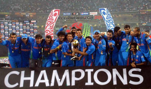 Indian team pose after winning the 2011 World Cup