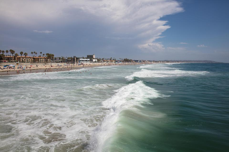 """<p><strong>Let's start big picture here.</strong><br> Mission Beach has all the makings of a Beach Boys' album cover: a bustling boardwalk, a colorful amusement park, and buzzing mix of locals and tourists.</p> <p><strong>Any standout features or must-sees?</strong><br> The most popular Mission Beach attraction is <a href=""""https://www.cntraveler.com/activities/san-diego/belmont-park?mbid=synd_yahoo_rss"""" rel=""""nofollow noopener"""" target=""""_blank"""" data-ylk=""""slk:Belmont Park"""" class=""""link rapid-noclick-resp"""">Belmont Park</a>, an amusement park that houses the longstanding Giant Dipper roller coaster built in 1925, bumper cars, and other classic carnival rides.</p> <p><strong>Was it easy to get around?</strong><br> The intersection of West Mission Bay Drive and Mission Boulevard, near Belmont Park, is considered the main drag in Mission Beach. Several businesses are within walking distance, including bike and surfboard rental shops, <a href=""""https://www.draftsandiego.com/"""" rel=""""nofollow noopener"""" target=""""_blank"""" data-ylk=""""slk:Draft"""" class=""""link rapid-noclick-resp"""">Draft</a> restaurant on the boardwalk, and <a href=""""https://www.missbcoconutclub.com/"""" rel=""""nofollow noopener"""" target=""""_blank"""" data-ylk=""""slk:Miss B's Coconut Club"""" class=""""link rapid-noclick-resp"""">Miss B's Coconut Club</a> tiki bar.</p> <p><strong>All said and done, what—and who—is this best for?</strong><br> Mission Beach never misses a beat: if you want to be where all the people are—especially the 20-somethings—this is a spot to hit in San Diego. If you're trying to """"just get away from it all"""", you might prefer other beaches that aren't as built up.</p>"""