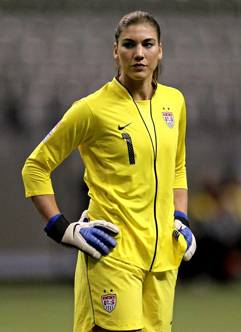 FILE - In this Jan. 20, 2012, file photo, United States goalkeeper Hope Solo (1) reacts during the first half of a CONCACAF women's Olympic qualifying soccer match against the Dominican Republic in Vancouver, British Columbia. Police in Kirkland, Wash., say former NFL football player Jerramy Stevens appeared in court Tuesday, Nov. 13, 2012, after being arrested hours earlier on suspicion of domestic violence assault. The Seattlepi.com reported that a Kirkland Municipal judge released Stevens saying there was no evidence connecting him to any assault. Stevens and Hope Solo applied for a marriage license last Thursday, according to King County records.  (AP Photo/The Canadian Press, Jonathan Hayward, File)