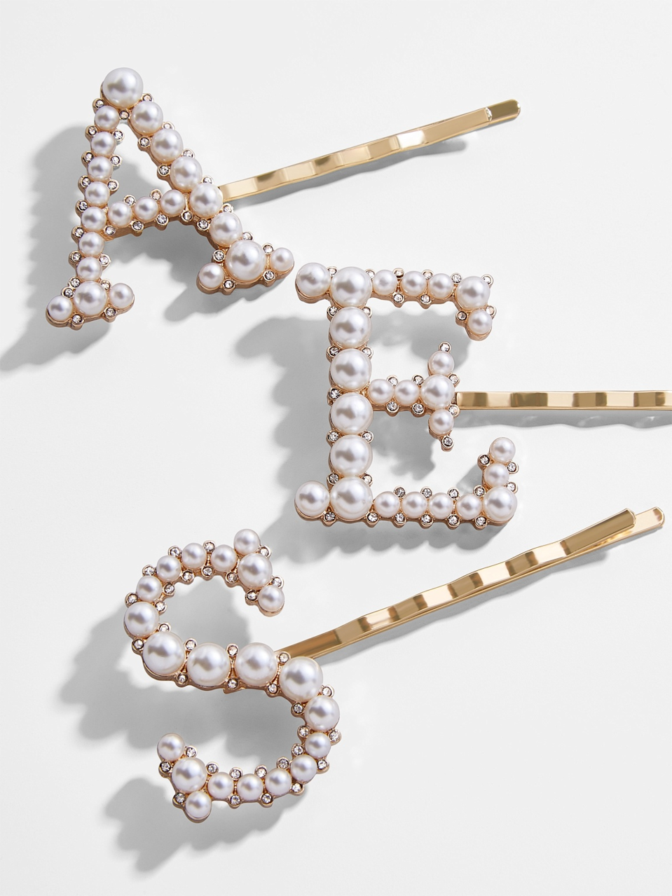 """<h3>Baublebar Baroque Initial Pearl Hair Pin</h3><br>Hair barrettes are fun, but pearled initial iterations of the trend are the best. <br><br>Shop <strong><em><a href=""""https://www.baublebar.com"""" rel=""""nofollow noopener"""" target=""""_blank"""" data-ylk=""""slk:Baublebar"""" class=""""link rapid-noclick-resp"""">Baublebar</a></em></strong><br><br><strong>BaubleBar</strong> Baroque Initial Pearl Hair Pin, $, available at <a href=""""https://go.skimresources.com/?id=30283X879131&url=https%3A%2F%2Fwww.baublebar.com%2Fproduct%2F49433-baroque-initial-pearl-hair-pin"""" rel=""""nofollow noopener"""" target=""""_blank"""" data-ylk=""""slk:BaubleBar"""" class=""""link rapid-noclick-resp"""">BaubleBar</a>"""