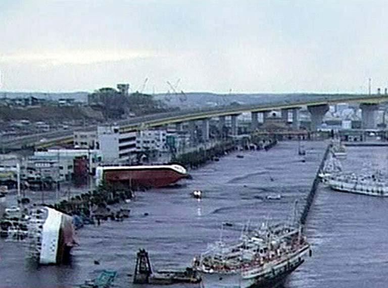 In this video image taken from Japan's NHK TV, ships and boats are washed ashore in Hachinohe, Aomori Prefectur, Japan Friday March 11, 2011 following a masive earth quake. A magnitude 8.9 earthquake slammed Japan's northeastern coast Friday, unleashing a 13-foot (4-meter) tsunami that swept boats, cars, buildings and tons of debris miles inland. Fires triggered by the quake burned out of control up and down the coast. (AP PHOTO/NHK TV)