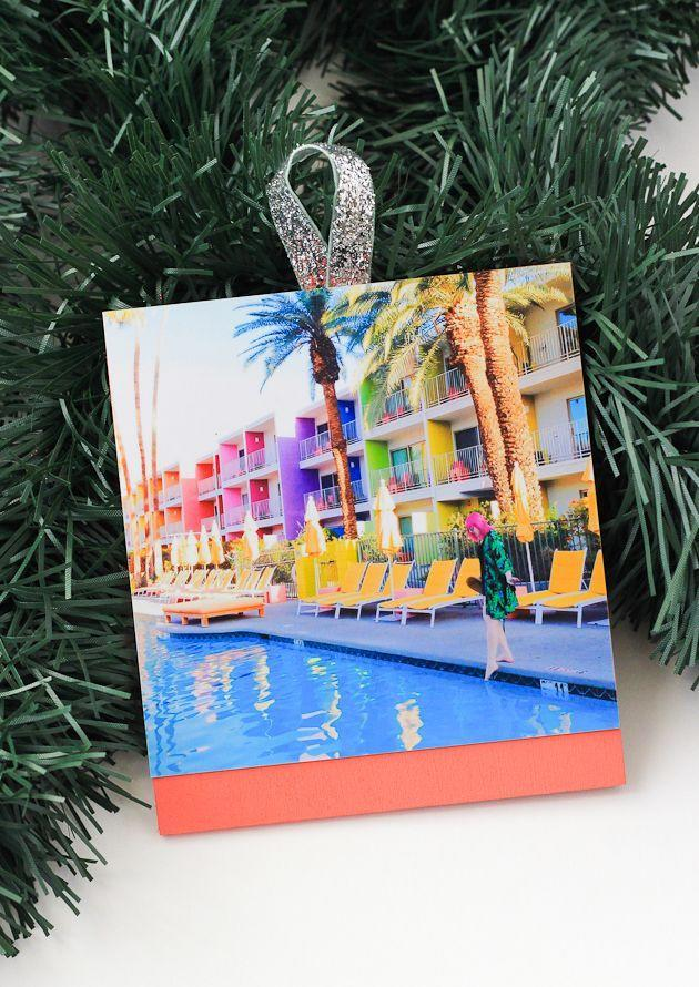 """<p>This is where all your Instagramming efforts finally come in handy. Pick your favorite snapshots, and display them on the tree for all to see.</p><p>Get the tutorial at <a href=""""https://thecraftedlife.com/diy-photo-ornaments/"""" rel=""""nofollow noopener"""" target=""""_blank"""" data-ylk=""""slk:The Crafted Life"""" class=""""link rapid-noclick-resp"""">The Crafted Life</a>.</p>"""