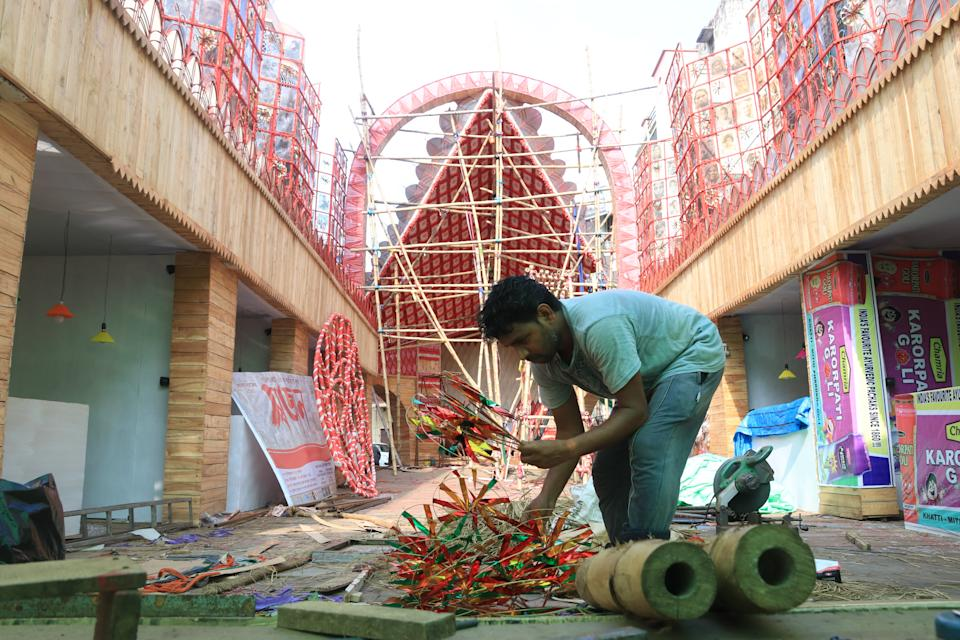 Indian Labor worked at a pandal ahead of Durga Puja Festival in Kolkata, on October 14, 2020. India is the second worst-nation in terms of confirmed coronavirus caseload. (Photo by Debajyoti Chakraborty/NurPhoto via Getty Images)