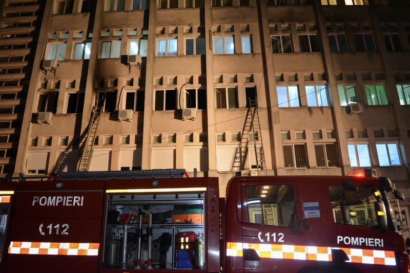 Firefighter ladders on the walls of the hospital in Piatra Neamt, where a fire killed 10 at COVID-19 intensive care unit