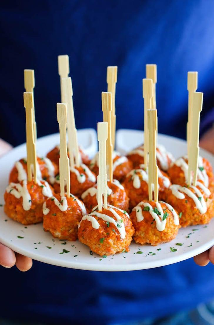 """<p>A healthier alternative to wings, these chicken meatballs will score you points on game day. You can make them before for easy noshing or you can cook them up day of. Top 'em off with a blue cheese dressing, and your taste buds will thank you.</p> <p><strong>Get the recipe</strong>: <a href=""""http://damndelicious.net/2014/04/30/slow-cooker-buffalo-chicken-meatballs/"""" class=""""link rapid-noclick-resp"""" rel=""""nofollow noopener"""" target=""""_blank"""" data-ylk=""""slk:slow-cooker buffalo chicken meatballs"""">slow-cooker buffalo chicken meatballs</a> </p>"""