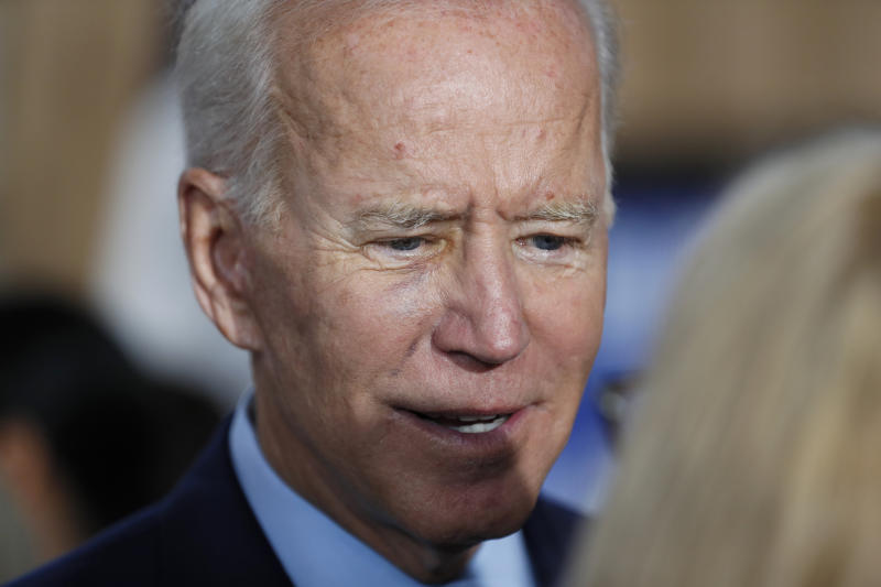 Democratic presidential candidate former Vice President Joe Biden speaks to an audience member during a community event, Wednesday, Aug. 7, 2019, in Burlington, Iowa. (AP Photo/Charlie Neibergall)