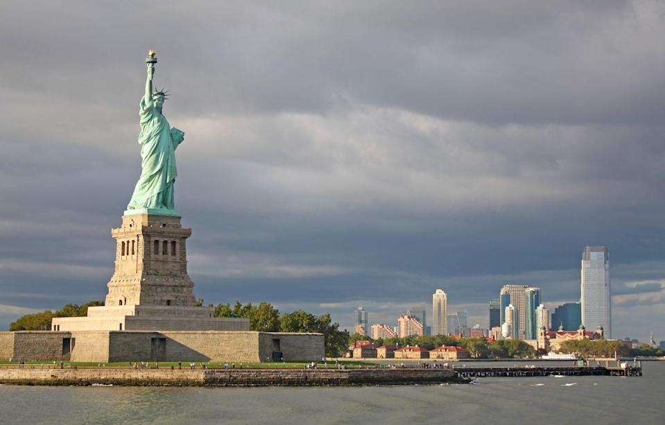 """<p><a href=""""https://www.nps.gov/stli/index.htm"""" rel=""""nofollow noopener"""" target=""""_blank"""" data-ylk=""""slk:Statue of Liberty National Monument"""" class=""""link rapid-noclick-resp""""><strong>Statue of Liberty National Monument </strong></a></p><p>New York has more than 30 National Park sites. While they are all impressive in their own ways, none is more iconic than the Statue of Liberty, who greets visitors in New York Harbor. You'll have to take a ferry to get up close, and buy tickets well in advance if you want to climb up to the crown, but it's worth it. Make sure to pair it with a trip to <a href=""""https://www.nps.gov/elis/index.htm"""" rel=""""nofollow noopener"""" target=""""_blank"""" data-ylk=""""slk:Ellis Island"""" class=""""link rapid-noclick-resp"""">Ellis Island</a>.</p>"""